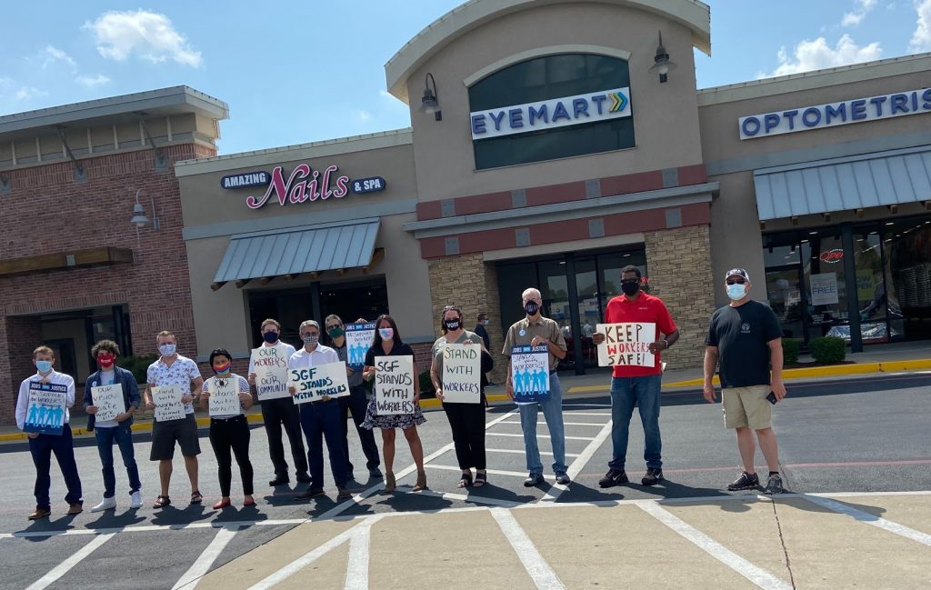 Eyemart protestors with signs outside store